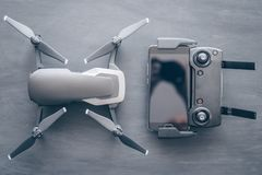 Innovation photography concept. Mate color. A new black drone on a black table. The concept of using drones in life. And industry. Top view Remote and royalty free stock images