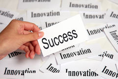 Innovation and success. Hand holding paper card with success word Stock Photography