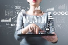 Innovation with woman using a tablet royalty free stock image