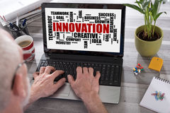 Innovation word cloud concept on a laptop screen. Innovation word cloud concept shown on a laptop used by a man royalty free stock image