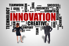 Innovation word cloud concept watched by business people Royalty Free Stock Image