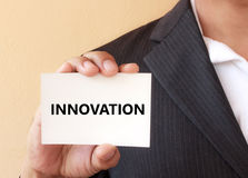 INNOVATION word on the white card Royalty Free Stock Photos