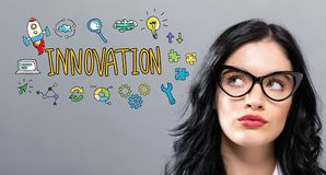 Innovation with young businesswoman. In a thoughtful face Stock Photo