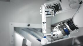 The innovative arms of a robotic arm make an injection of chemotherapy for a cancer patient. New technologies in
