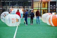 Innovative bubble soccer manhattan new york. There is innovative sport on the soccer field in Manhattan , New York ,safe and for all ages nice outdoor activity Royalty Free Stock Photos
