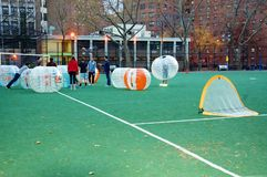 Innovative bubble soccer manhattan new york. There is innovative sport on the soccer field in Manhattan , New York ,safe and for all ages nice outdoor activity Stock Images