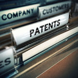 Innovative Company Concept. Folder and focus on a tab with the word patents, blur effect. Concept of company innovation Royalty Free Stock Photo
