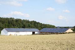 Innovative Farm. Barn of a farm with solar panels on the roof Royalty Free Stock Photography