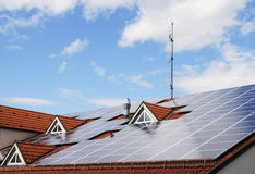 Innovative house roof. Photovoltaic system on the roof of a house Royalty Free Stock Photography