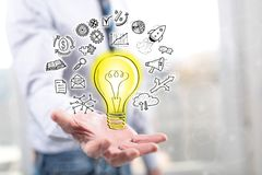 Concept of innovative idea. Innovative idea concept above the hand of a man in background stock photo