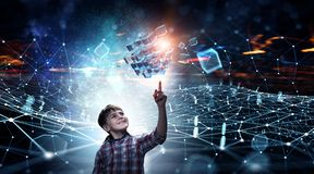 Innovative impressive technologies. Kid boy and media cube figure as symbol for technologies. 3d rendering Royalty Free Stock Image
