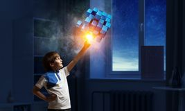 Innovative impressive technologies. Kid boy and media cube figure as symbol for technologies. 3d rendering Royalty Free Stock Images