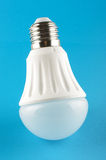 Innovative LED light lamp isolated on the blue background Royalty Free Stock Image