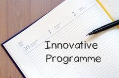 Innovative programme write on notebook. Innovative programme text concept write on notebook with pen stock photos