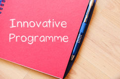 Innovative programme write on notebook. Innovative programme text concept write on notebook with pen stock images