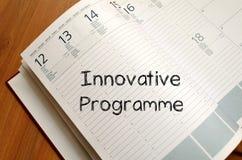 Innovative programme write on notebook Stock Photos