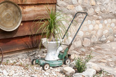Innovative recycling of a lawnmower and toilet bowl Stock Image