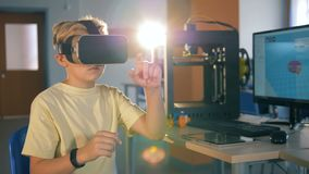 Innovative technologies in education. School boy is playing virtually being in 3D glasses. stock footage