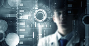 Innovative technologies in medicine . Mixed media. Young male doctor and new media technologies Stock Images