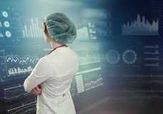 Innovative technologies in science and medicine. Beautiful female doctor. 3D illustration elements in collage Stock Photos