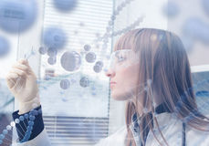 Innovative technologies in science and medicine. Beautiful female doctor examining a slide Royalty Free Stock Photography