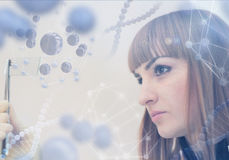Innovative technologies in science and medicine. Beautiful female doctor examining a slide stock images