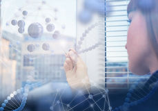 Innovative technologies in science and medicine. Beautiful female doctor examining a slide Royalty Free Stock Photo