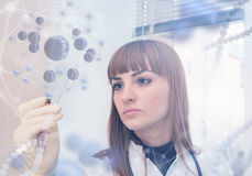 Innovative technologies in science and medicine. Beautiful female doctor examining a slide Royalty Free Stock Photos