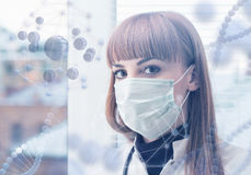 Innovative technologies in science and medicine. Beautiful female doctor in a mask Stock Photography