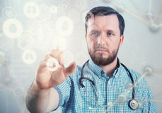 Innovative technologies in science and medicine. Male doctor Royalty Free Stock Photography