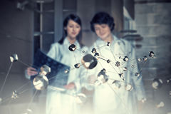 Innovative technologies in science and medicine . Mixed media. Two young scientists in laboratory and social connection concept. Mixed media Royalty Free Stock Image