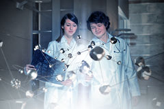 Innovative technologies in science and medicine . Mixed media. Two young scientists in laboratory and social connection concept. Mixed media Royalty Free Stock Images