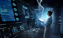 Innovative technologies in science and medicine . Mixed media. Young woman scientist using tablet pc in her hands. Mixed media . 3D rendering Royalty Free Stock Photo