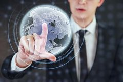 Innovative technologies in science and medicine. Technology to connect. Holding glowing planet earth Stock Photo