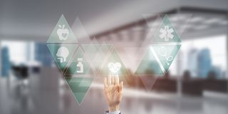 Innovative technologies for science and medicine in use by female doctor or scientist. Hand of woman touching icon of media screen with medicine concept Royalty Free Stock Image