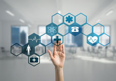 Innovative technologies for science and medicine in use by female doctor or scientist. Hand of woman touching icon of media screen with medicine concept Stock Photos