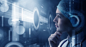 Innovative technologies in science and medicine. Young woman scientist looking at virtual media screen Stock Image