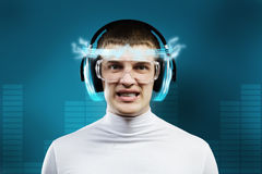 Innovative technologies. Young handsome man in glasses and virtual headphones Stock Images