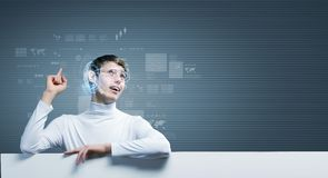 Innovative technologies. Young man wearing futuristic glasses against blue background with white banner Stock Image