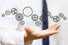 Innovator showing connected sprockets,  ideas and changing techn Royalty Free Stock Image