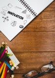 Innowaci doodle na notepad obok ołówków i szkieł Zdjęcia Stock