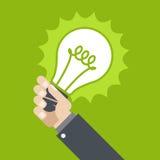 Innowacja - błyszczeć lampę w ręce Fotografia Stock
