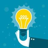 Innowacja - ręka z olśniewającą żarówką Zdjęcia Stock