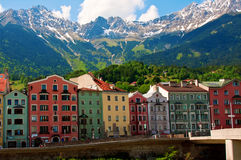 Innsbruck. A row of colourful houses in Innsbruck Austria with the alps in the background Stock Images