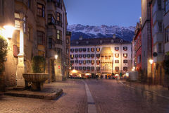 Innsbruck, Austria. The Golden Roof as seen from along the pedestrian Herzog-Friedrich Street in evening in Innsbruck, Austria. Some fresh snow is covering the Royalty Free Stock Photo