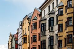 Low angle view of old buildings in old town of Innsbruck. Innsbruck, Austria - August 9, 2017: Low angle view of old buildings in Christkindlmarkt near Goldenen Stock Image