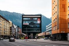 Modern bus station of Innsbruck against mountains. Innsbruck, Austria - August 9, 2017: Modern architecture building containing the bus station of Innsbruck Stock Photo