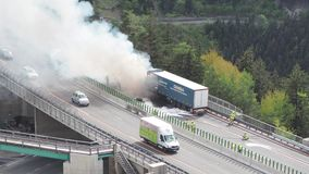 Innsbruck, Austria. Burning truck on the Brenner motorway near the Europa bridge. Highway between Austria and Italy. Extreme danger for vehicles moving in the stock video