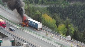 Innsbruck, Austria. Burning truck on the Brenner motorway near the Europa bridge. Highway between Austria and Italy. Extreme danger for vehicles moving in the stock footage