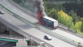 Innsbruck, Austria. Burning truck on the Brenner motorway near the Europa bridge. Highway between Austria and Italy. Extreme danger for vehicles moving in the stock video footage